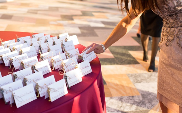 a planner straightening the guests' name cards