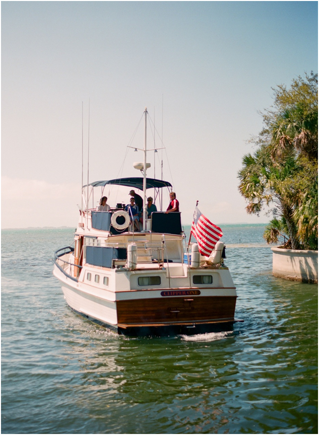 A yacht transporting the groomsmen and groom to the ceremony location