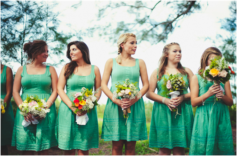 Bridesmaid dresses at a ceremony at a public beach access on Longboat Key, FL